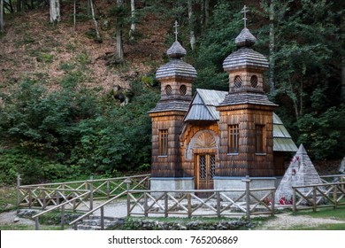 Famous Russian Chapel (Ruska Kapelica) settled in the wood on slopes of Julian alps, under the Vrsic pass. Acient wooden russian church, historic slovenian landmark and sight from World War I.
