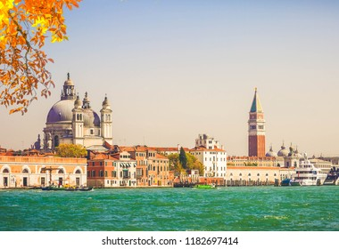 famous San Marco square waterfront with Basilica Santa Maria della Salute and San Marco bell tower, Venice, Italy at fall