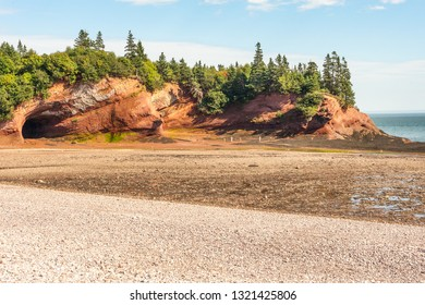 Famous sandstone sea caves near St Martins village at low tide, New Brunswick, Canada