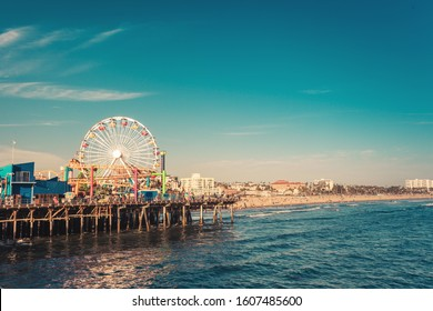 Famous Santa Monica ferris wheel amusement park in sunset light, no logo