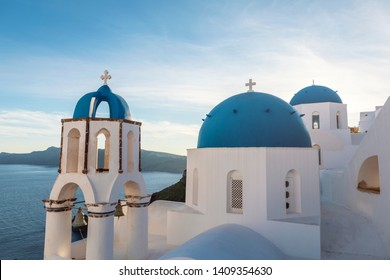 famous Santorini blue church domes in Oia
