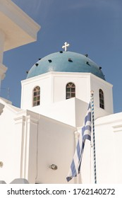 The famous Santorini blue domes the greek churches at nightfall