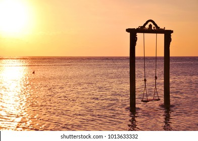 The famous scene of swing in sunset at the beach of Gili Trawangan, the paradise island, close to Bali and Lombok, Indonesia