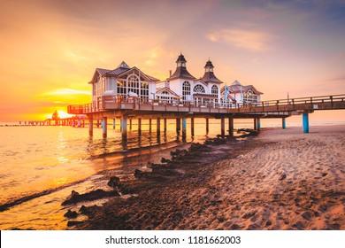 Famous Sellin Seebruecke (Sellin Pier) in beautiful golden morning light at sunrise in summer, Ostseebad Sellin tourist resort, Baltic Sea region, Germany
