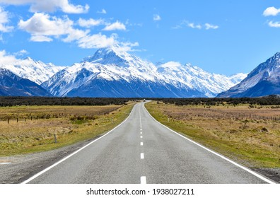 Famous shot of the snow-covered Southern Alps with the straight road leading directly towards Aoraki Mount Cook. South Island, New Zealand
