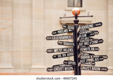 Famous signpost with directions to world landmarks in Pioneer Courthouse Square, Portland, Oregon