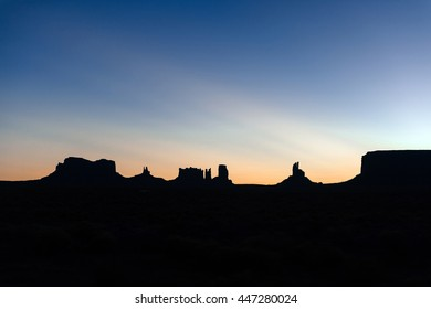 famous silhouette of sandstone in monument valley, sunrise