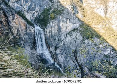 Famous slovenian waterfall Boka in Julian Alps in Triglav National park. Boka waterfall in karst alpine landscape. Nature waterfall, one of the highest in Slovenia. Slap Boka.