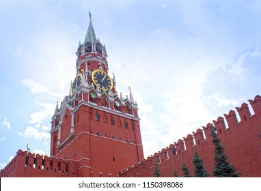 The famous Spasskaya tower of Moscow Kremlin, Russia. Spasskaya tower on the blue sky background. Ancient Kremlin is the main landmark of Moscow. Beautiful view of Spasskaya tower in the sunlight.
