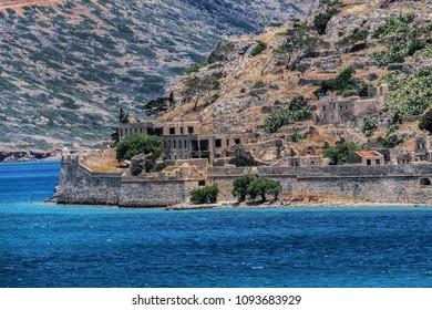 Famous Spinalonga island (Kalidon), former leper colony and fortress at Plaka, Elounda bay of Crete island in Greece.