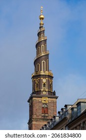 The famous spire with its spiral exterior staircase of the bell tower of Vor Frelsers Kirke, (Church of Our Saviour) at Copenhagen, Denmark