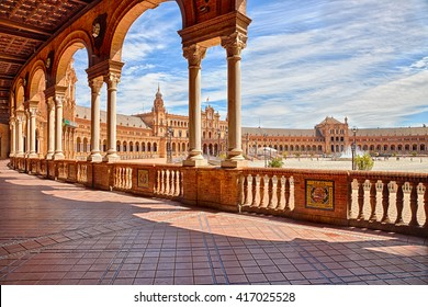 The famous Square of Spain, in Spanish Plaza de Espana, view from the path with columns, one example of the mixing Regionalism Architecture Renaissance and Moorish styles. Seville, Andalucia, Spain.