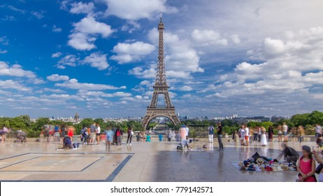 Famous square Trocadero with Eiffel tower in the background. Trocadero and Eiffel tower are the most visited attractions of Paris. Blue cloudy sky at summer day