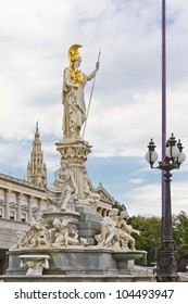 Famous statue of Pallas Athena and fountain in front of the Austrian Parliament in Vienna, Europe