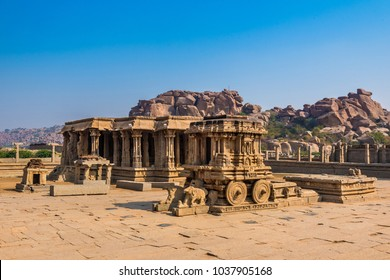 Famous stone chariot and adjoining Vittala temple well known for its marvelous architecture in Hampi, India. These ruins are from the Hindu Vijayanagara empire which existed in the 14th century.