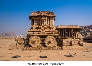Famous stone chariot in Vittala temple well known for its exceptional architecture in Hampi, India. These ruins are from the Hindu Vijayanagara empire which existed in the 14th century.