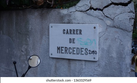 A famous street in Barcelona, Spain - Carrer de Mercedes, vandalized in a fun way in Bansky's style, adding the initials of an emblematic German car model - 209d