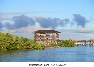 Famous surfing spot cloud 9, wooden hut with gangway and surfers on it, Siargao island, Philippines