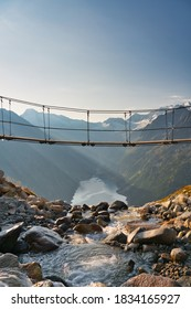 Famous suspended bridge in the austrian alps (Zillertal) with a view of the lake Schlegeis (Schlegeisspeicher) and the surrounding mountains during sunrise. Located near the the popular Olperer hut.