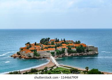 Famous Sveti Stefan island in Budva during a beautiful summer day, Montenegro