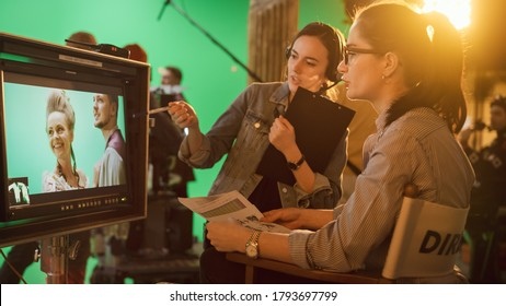 Famous Talented Female Director in Chair Looks at Display talks with Assistant, Shooting Blockbuster. Green Screen Scene in Historical Drama. Film Studio Set Professional Crew Doing High Budget Movie - Shutterstock ID 1793697799