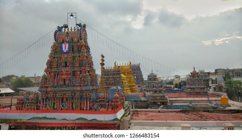 a famous temple in chennai sri parthasarathy temple located at triplicane seen with temple tower aligned in one line with gold plated main tower