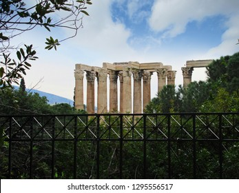 The famous Temple of Olympian Zeus in Athens, Greece - view of the top of the corinthian pillars from behind a fence.