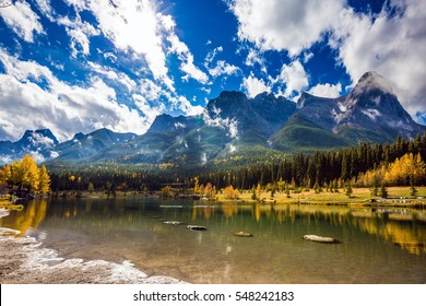 The famous Three Sisters mountains in the Canadian Rockies  of Canada. Auroral sunny day in Canmore. Concept of hiking