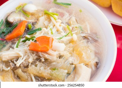 Famous tofu soup with vegetables pork and mushroom, Thai style food.