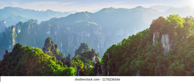 Famous tourist attraction of China - panorama of Zhangjiajie stone pillars cliff mountains on sunset at Wulingyuan, Hunan, China