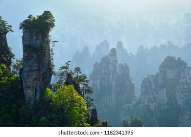 Famous tourist attraction of China - Zhangjiajie stone pillars cliff mountains on sunset at Wulingyuan, Hunan, China