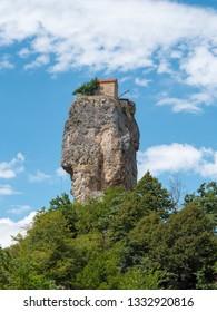 Famous touristic landmark Katskhi Pillar with ancient Orthodox church on top in Chiatura, Georgia