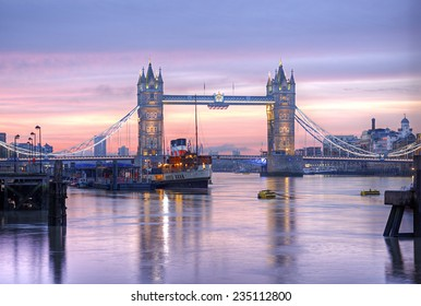 Famous Tower Bridge in front of colorful sky at morning before sunrise, HDR image, London, England, United Kingdom