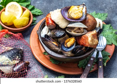 Famous traditional dish of the south of Chile and the Chiloe archipelago - Curanto Kuranto.  Different seafood and meat cooked in a pit on the coals under the ground.