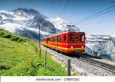 Famous Train with Jungfrau Mountain on Sunny Day