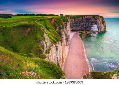 Famous travel and photography destination, natural cliffs Aval of Etretat and majestic fantastic coastline, Normandy, France, Europe