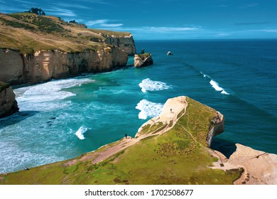 Famous Tunnel beach in New Zealand, DUNEDIN, NEW ZEALAND Popular tourist attraction in Dunedin, South island of New Zealand, amazing coast line from above with a drone, Cliff formations Tunnel Beach