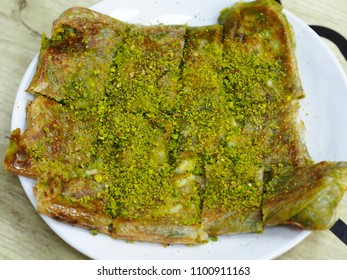 famous turkey gaziantep dessert (katmer) on white plate