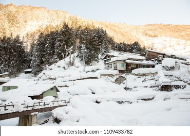 A famous valley hot spring covered in snow at Yamanouchi in Nagano, Japan. Jigokudani Monkey Park is in Yamanouchi