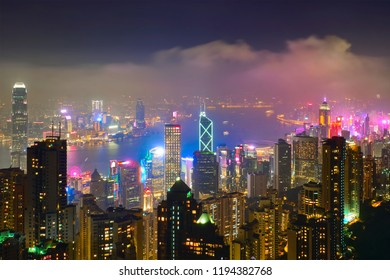 Famous view of Hong Kong - Hong Kong skyscrapers skyline cityscape view from Victoria Peak illuminated in the evening blue hour. Hong Kong, China