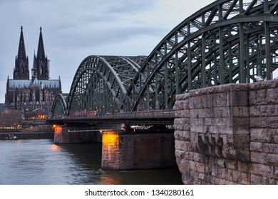 The famous view of the landmarks of Cologne by day. Hundreds of trains and thousands of people pass through the Hohenzollern Bridge every day while enjoying the view of Cologne's panorama.