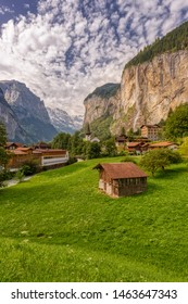 Famous view of Lauterbrunnen town in Swiss Alps valley with gorgeous Staubbach waterfalls in the background, Switzerland.