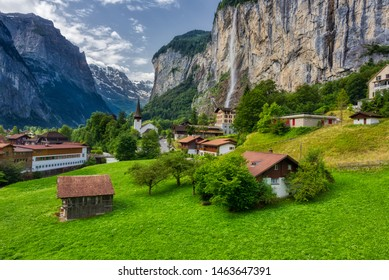 Famous view of Lauterbrunnen town in Swiss Alps valley with gorgeous Staubbach waterfalls in the background, Switzerland