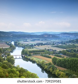 The famous view of the River Dordogne from the bastide of Domme, Aquitaine, France, in the early morning, as summer turns to autumn.