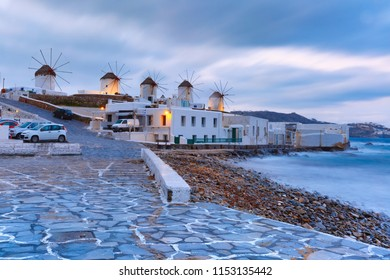 Famous view, Traditional windmills at sunrise in Mykonos City, Chora, on the island Mykonos, The island of the winds, Greece