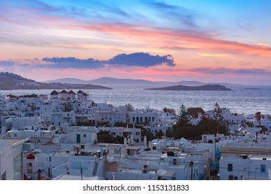 Famous view, Traditional windmills at sunset in Mykonos City, Chora, on the island Mykonos, The island of the winds, Greece