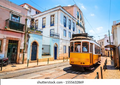 Famous vintage tram in the street of Alfama, Lisbon, Portugal