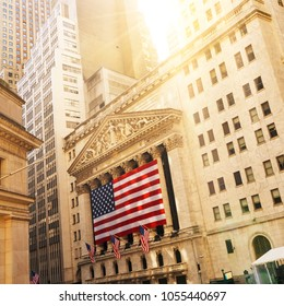 Famous Wall street and the building in New York, New York with patriot flag