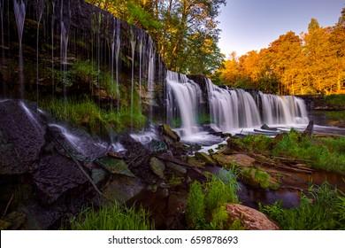 Famous waterfall in Estonia. Keila-Joa Schloss Fall. Amazing panorama of Estonian nature.