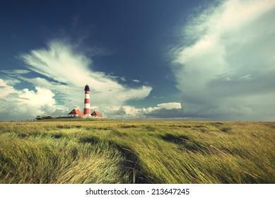 famous Westerhever lighthouse at North Sea coast, Schleswig-Holstein, Germany, Europe, vintage style, Leuchtturm Westerhever an der deutschen Nordseekueste, Nordfriesland, Deutschland, Europa